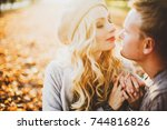 portrait of couple in autumn on ... | Shutterstock . vector #744816826