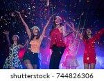 dancing in club.cheering crowd... | Shutterstock . vector #744826306