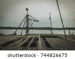 old abandoned wooden harbor... | Shutterstock . vector #744826675