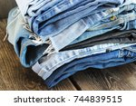 various colors jeans stacked on ... | Shutterstock . vector #744839515