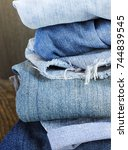 various colors jeans stacked on ... | Shutterstock . vector #744839545