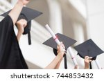 Success Women are Celebrating Graduation Put Hand Up, a Certificate and a Hat in hand, Happiness Feeling, Commencement Day.Congratulated the Graduates in University.Graduation Ceremony Day Concept.