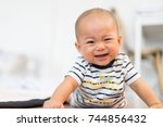 seven month old baby crying.sad ... | Shutterstock . vector #744856432
