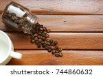 coffee beans in a glass... | Shutterstock . vector #744860632