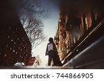 reflection of woman walking on... | Shutterstock . vector #744866905