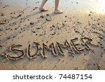 the word summer written in sand - stock photo