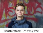 portrait of a smiling teenager... | Shutterstock . vector #744919492