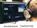 man doing video editing on... | Shutterstock . vector #744919735