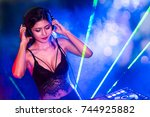 sexy asian dj mixing music in... | Shutterstock . vector #744925882