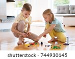 two curious happy children... | Shutterstock . vector #744930145