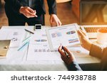 two businessman investment... | Shutterstock . vector #744938788