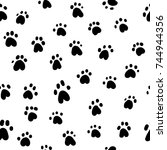 paw print seamless. traces of...   Shutterstock .eps vector #744944356