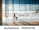 view on the aiport window with... | Shutterstock . vector #744944746