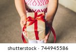 the girl holds box with gift... | Shutterstock . vector #744945586