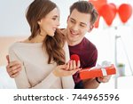 loving boyfriend surprising his ... | Shutterstock . vector #744965596