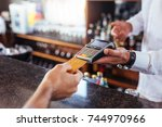 Customer Making Payment Using...