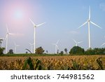 big turbine and corn farm with... | Shutterstock . vector #744981562