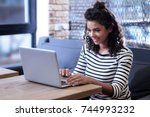 happy girl working on the laptop | Shutterstock . vector #744993232
