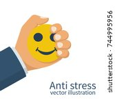man holds in hand squeezing an... | Shutterstock .eps vector #744995956