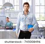 young architect leaving office... | Shutterstock . vector #745008496