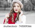 street portrait of young... | Shutterstock . vector #745009366