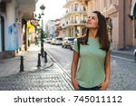 young beautiful woman travels... | Shutterstock . vector #745011112