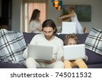 son imitating father sitting on ...   Shutterstock . vector #745011532