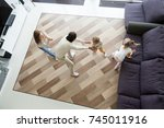 family playing hide and seek... | Shutterstock . vector #745011916