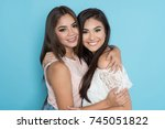 two hispanic teen friends on a... | Shutterstock . vector #745051822