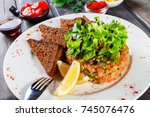 tartar with salmon and avocado... | Shutterstock . vector #745076476