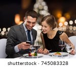 people  technology and holiday... | Shutterstock . vector #745083328