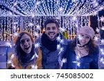 friends having fun outdoors on... | Shutterstock . vector #745085002