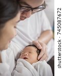 asian parents with newborn baby ... | Shutterstock . vector #745087672