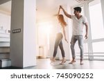 romantic couple at home.... | Shutterstock . vector #745090252