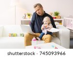 busy father working with... | Shutterstock . vector #745093966