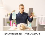 man doesn't know how to change... | Shutterstock . vector #745093975