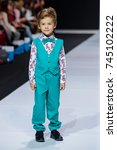 Small photo of MOSCOW, RUSSIA - OCTOBER 28, 2017: Model walk runway for FASHION BOOK by ALENA STEPINA catwalk at Spring-Summer 2018 Season Moscow Fashion Week. Kid's fashion.