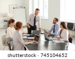 team of young professionals... | Shutterstock . vector #745104652