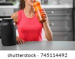 young woman drinking protein... | Shutterstock . vector #745114492