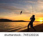 young man fishing on a lake at... | Shutterstock . vector #745120216