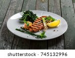 plate with delicious grilled... | Shutterstock . vector #745132996