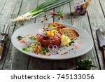 tasty tartare with toasted... | Shutterstock . vector #745133056