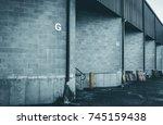 warehouse dock garage doors.... | Shutterstock . vector #745159438