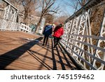 mother and daughter walking on... | Shutterstock . vector #745159462