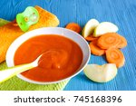 puree of baby carrot apple on a ... | Shutterstock . vector #745168396