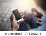 selective focus.man holding and ... | Shutterstock . vector #745202248