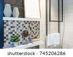wooden wall shelf with... | Shutterstock . vector #745206286
