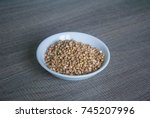 raw buckwheat in white ceramic... | Shutterstock . vector #745207996