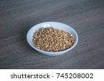 raw buckwheat in white ceramic... | Shutterstock . vector #745208002
