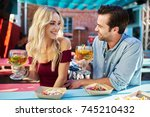 attractive romantic couple... | Shutterstock . vector #745210432
